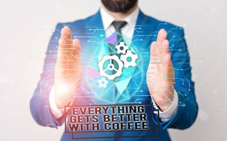Handwriting text writing Everything Gets Better With Coffee. Conceptual photo Have a hot drink when having problems Male human wear formal work suit presenting presentation using smart device