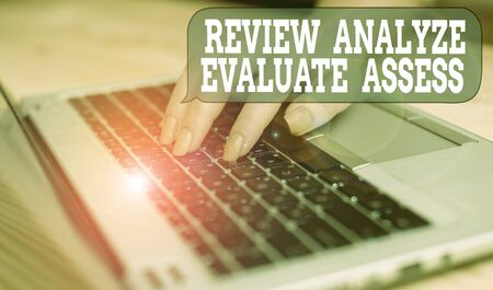 Writing note showing Review Analyze Evaluate Assess. Business concept for Evaluation of perforanalysisce feedback process woman with laptop smartphone and office supplies technology Фото со стока