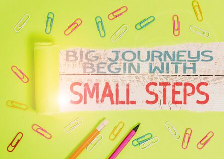 Conceptual hand writing showing Big Journeys Begin With Small Steps. Concept meaning One step at a time to reach your goals Banco de Imagens