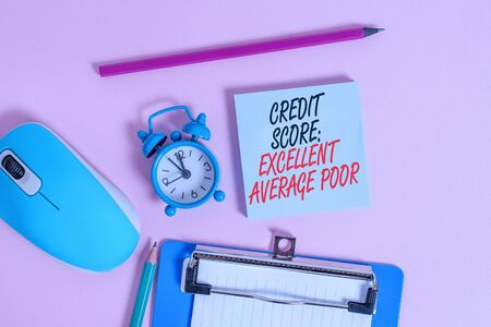 Conceptual hand writing showing Credit Score Excellent Average Poor. Concept meaning Level of creditworthness Rating Report Alarm clock notepad clipboard paper markers color background