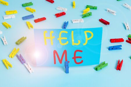 Handwriting text Help Me. Conceptual photo Asking someone to assist you Shouting for it Teamwork Volunteer Colored clothespin papers empty reminder blue floor background office pin