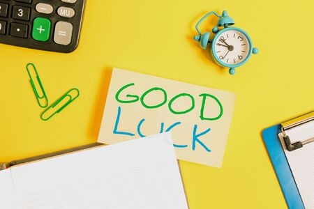 Text sign showing Good Luck. Business photo showcasing A positive fortune or a happy outcome that a demonstrating can have Empty orange paper with copy space on the yellow table