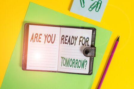 Conceptual hand writing showing Are You Ready For Tomorrow Question. Concept meaning Preparation to the future Motivation Locked diary striped sheets clips notepad colored background 스톡 콘텐츠