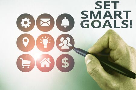 Conceptual hand writing showing Set Smart Goals. Concept meaning list to clarify your ideas focus efforts use time wisely Male designing layout presentation concept for business promotion