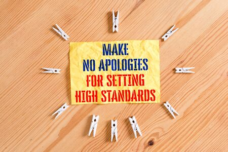 Writing note showing Make No Apologies For Setting High Standards. Business concept for Seeking quality productivity Colored clothespin papers empty reminder wooden floor background office