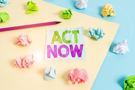 Handwriting text Act Now. Conceptual photo Having fast response Asking someone to do action Dont delay Colored crumpled papers empty reminder blue yellow background clothespin