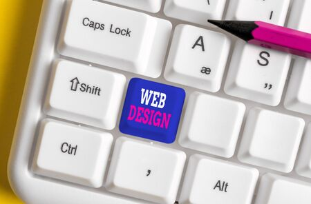 Text sign showing Web Design. Business photo text who is responsible of production and maintenance of websites White pc keyboard with empty note paper above white background key copy space