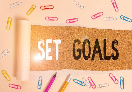 Handwriting text writing Set Goals. Conceptual photo Defining or achieving something in the future based on plan