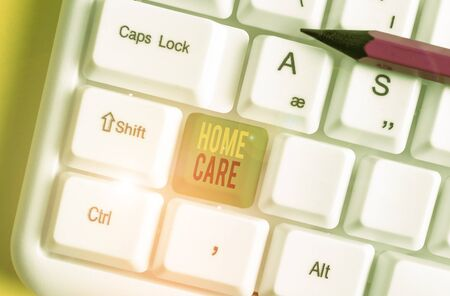 Word writing text Home Care. Business photo showcasing Place where showing can get the best service of comfort rendered White pc keyboard with empty note paper above white background key copy space