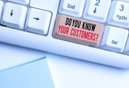 Writing note showing Do You Know Your Customers Question. Business concept for having a great background about clients White pc keyboard with note paper above the white background Фото со стока