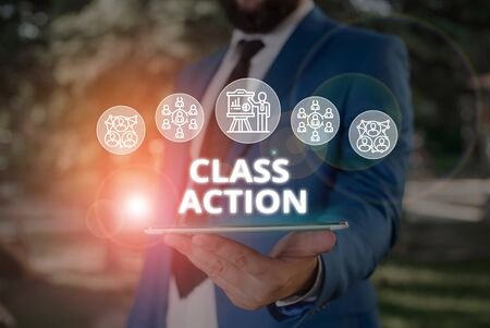 Word writing text Class Action. Business photo showcasing lawsuit filed by small group acting on behalf of a large group Male human wear formal work suit presenting presentation using smart device