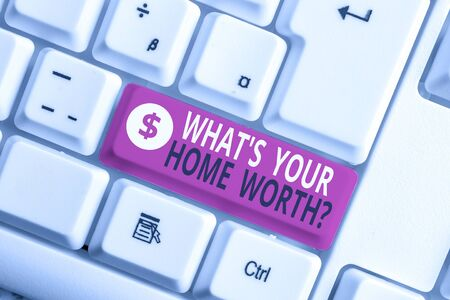 Writing note showing What S Your Home Worth Question. Business concept for Value of a house Property Cost Price Rate White pc keyboard with note paper above the white background