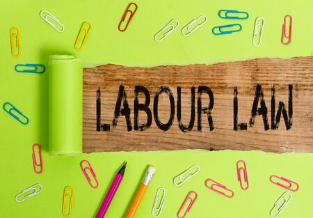 Conceptual hand writing showing Labour Law. Concept meaning Rules implemented by the state between employers and employee Stockfoto
