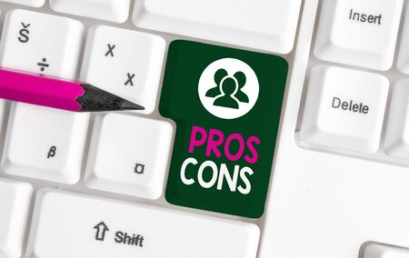 Text sign showing Pros Cons. Business photo text The favorable and unfavorable factors or reasons of demonstrating White pc keyboard with empty note paper above white background key copy space