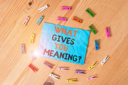 Word writing text What Gives You Meaning Question. Business photo showcasing your purpose or intentions in life Colored clothespin papers empty reminder wooden floor background office Stock Photo