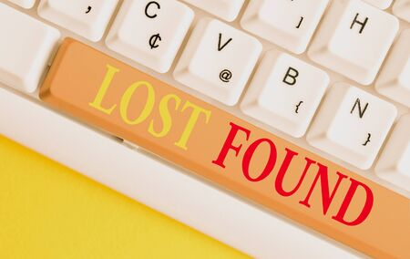 Conceptual hand writing showing Lost Found. Concept meaning Things that are left behind and may retrieve to the owner White pc keyboard with note paper above the white background
