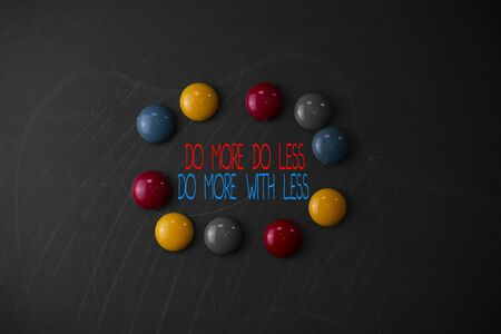 Conceptual hand writing showing Do More Do Less Do More With Less. Concept meaning dont work hard work smart be unique Round Flat shape stones with same sizes stick black board Stok Fotoğraf
