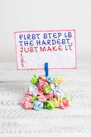 Conceptual hand writing showing First Step Is The Hardest Just Make It. Concept meaning dont give up on final route Reminder pile colored crumpled paper clothespin wooden space