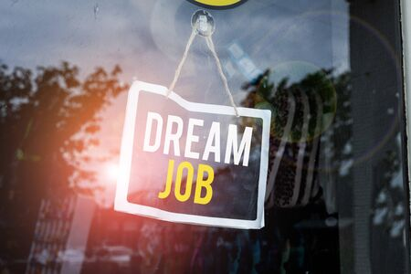 Text sign showing Dream Job. Business photo text An act that is paid of by salary and giving you hapiness Empty black board with copy space for advertising. Blank dark board