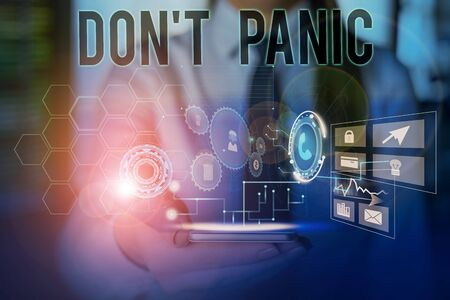 Conceptual hand writing showing Don T Panic. Concept meaning sudden strong feeling of fear prevents reasonable thought Woman wear work suit presenting presentation smart device