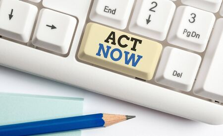Writing note showing Act Now. Business concept for Having fast response Asking someone to do action Dont delay White pc keyboard with note paper above the white background