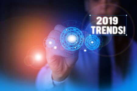 Text sign showing 2019 Trends. Business photo showcasing general direction in which something is developing or changing Woman wear formal work suit presenting presentation using smart device