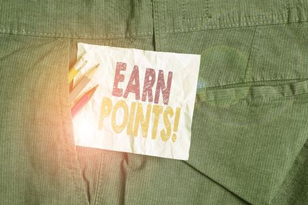 Text sign showing Earn Points. Business photo showcasing collecting scores in order qualify to win big prize Writing equipment and white note paper inside pocket of man work trousers