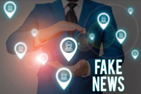 Word writing text Fake News. Business photo showcasing Giving information to showing that is not true by the media Male human wear formal work suit presenting presentation using smart device