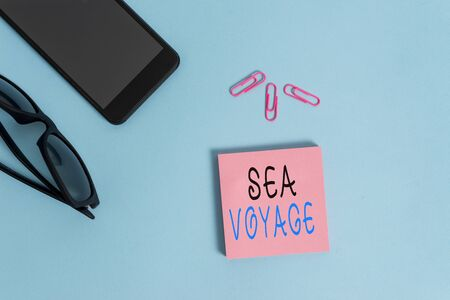 Conceptual hand writing showing Sea Voyage. Concept meaning riding on boat through oceans usually for coast countries Eyeglasses colored sticky note smartphone pastel background