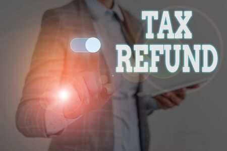 Writing note showing Tax Refund. Business concept for applied when money liability is less than the paid ones Woman wear formal work suit presenting presentation using smart device