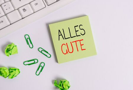 Handwriting text Alles Gute. Conceptual photo geranalysis translation all the best for birthday or any occasion Square empty green note paper with pencil on the white background and pc keyboard Фото со стока