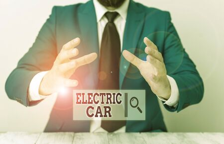 Handwriting text writing Electric Car. Conceptual photo an automobile that is propelled by one or more electric motors Man holds empty paper with copy space in front of him Space Banco de Imagens
