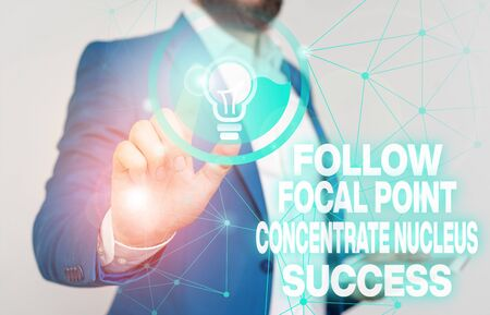 Word writing text Follow Focal Point Concentrate Nucleus Success. Business photo showcasing Concentration look for target Male human wear formal work suit presenting presentation using smart device