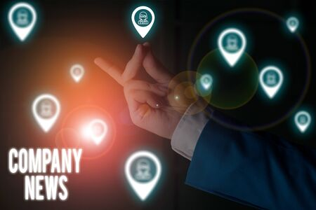 Text sign showing Company News. Business photo showcasing provides news and feature articles about the company status Male human wear formal work suit presenting presentation using smart device Stok Fotoğraf
