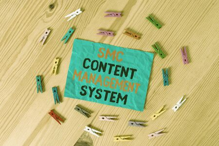 Word writing text Smc Content Management System. Business photo showcasing analysisgae creation and modification of posts Colored clothespin papers empty reminder wooden floor background office Stok Fotoğraf