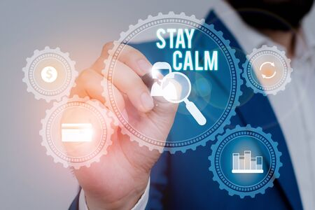 Text sign showing Stay Calm. Business photo showcasing Maintain in a state of motion smoothly even under pressure Male human wear formal work suit presenting presentation using smart device