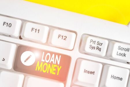 Writing note showing Loan Money. Business concept for Something lent or furnished on condition being returned White pc keyboard with note paper above the white background