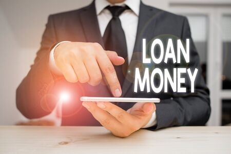 Writing note showing Loan Money. Business concept for Something lent or furnished on condition being returned Stok Fotoğraf
