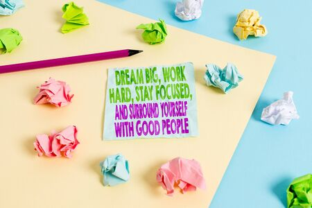 Handwriting text Dream Big Work Hard Stay Focused. Conceptual photo Dream Big Work Hard Stay Focused And Surround Yourself With Good People Colored crumpled papers empty reminder blue yellow background clothespin