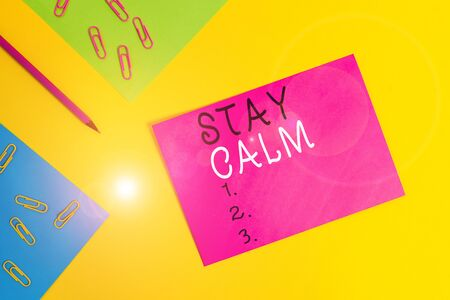 Word writing text Stay Calm. Business photo showcasing Maintain in a state of motion smoothly even under pressure Blank paper sheets message pencil clips binders plain colored background