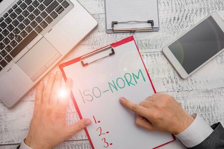 Conceptual hand writing showing Iso Norm. Concept meaning An accepted standard or a way of doing things most showing agreed Imagens