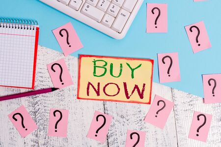 Text sign showing Buy Now. Business photo text asking someone to purchase your product Provide good Discount Writing tools, computer stuff and math book sheet on top of wooden table Stok Fotoğraf