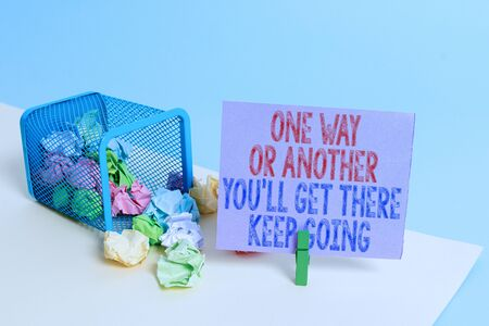 Word writing text One Way Or Another You Ll Get There Keep Going. Business photo showcasing Keep trying to succeed Trash bin crumpled paper clothespin empty reminder office supplies tipped