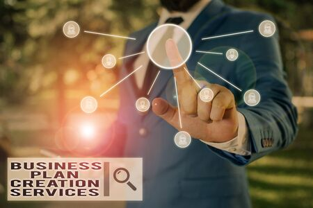 Text sign showing Business Plan Creation Services. Business photo text paying for professional to create strategy Male human wear formal work suit presenting presentation using smart device