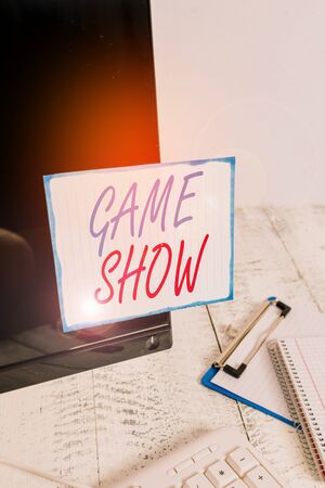 Writing note showing Game Show. Business concept for Program in television or radio with players that win prizes Note paper taped to black computer screen near keyboard and stationary