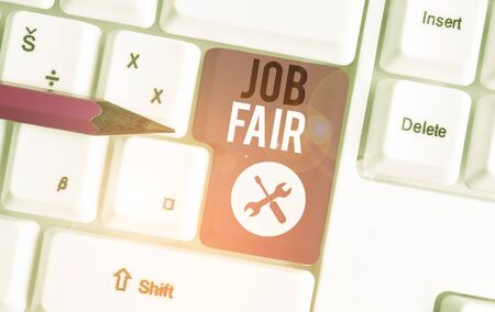 Text sign showing Job Fair. Business photo showcasing An event where a demonstrating can apply for a job in multiple companies White pc keyboard with empty note paper above white background key copy space