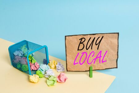 Handwriting text writing Buy Local. Conceptual photo Patronizing products that isoriginaly made originaly or native Trash bin crumpled paper clothespin empty reminder office supplies tipped