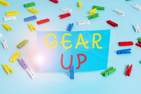 Handwriting text Gear Up. Conceptual photo Asking someone to put his clothes or suit on Getting ready fast Colored clothespin papers empty reminder blue floor background office pin