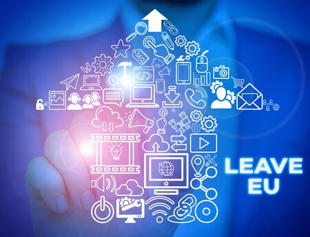 Text sign showing Leave Eu. Business photo showcasing An act of a demonstrating to leave a country that belongs to Europe Male human wear formal work suit presenting presentation using smart device Stock fotó