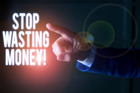 Word writing text Stop Wasting Money. Business photo showcasing advicing demonstrating or group to start saving and use it wisely Isolated hand pointing with finger. Business concept pointing finger 写真素材